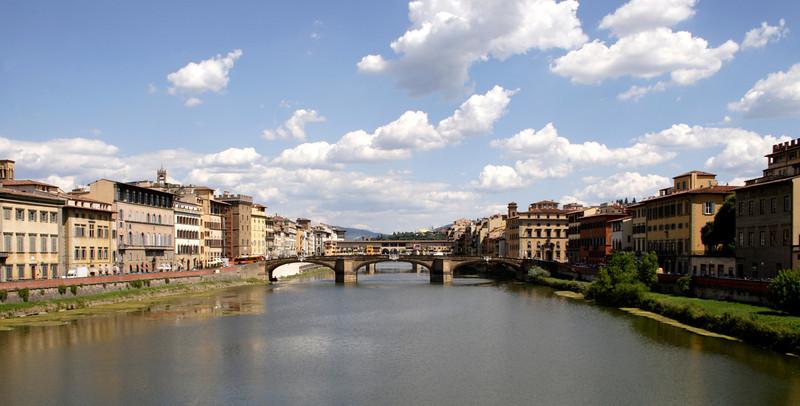 View along River Arno towards Ponte Santa Trinita bridge Florence