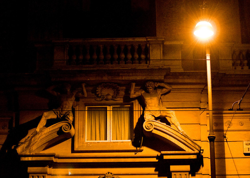 Title: Holding Up the Balcony<br /> Date: September 2011<br /> Decorations on a random building in Rome.