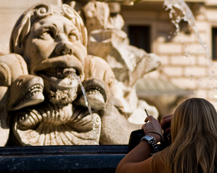 Title: Smoking Pictures<br /> Date: October 2011<br /> A tourist taking a picture of a fountain in the Piazza della Rotonda.