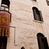Title: Flag Among Windows<br /> Date: October 2011<br /> Venice