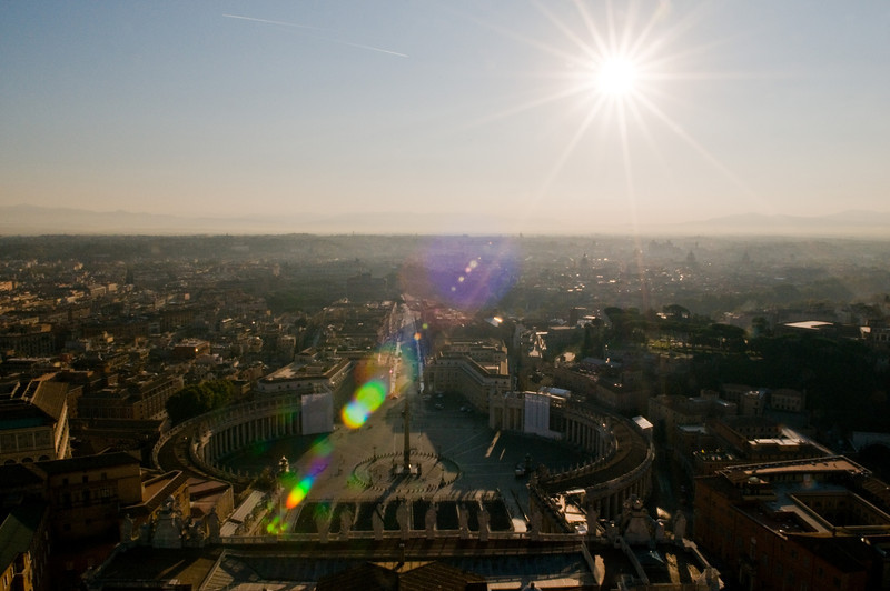 Title: Sunburst Over Rome<br /> Date: October 2011<br /> Looking out over Rome from the top of Saint Peter's Basilica.