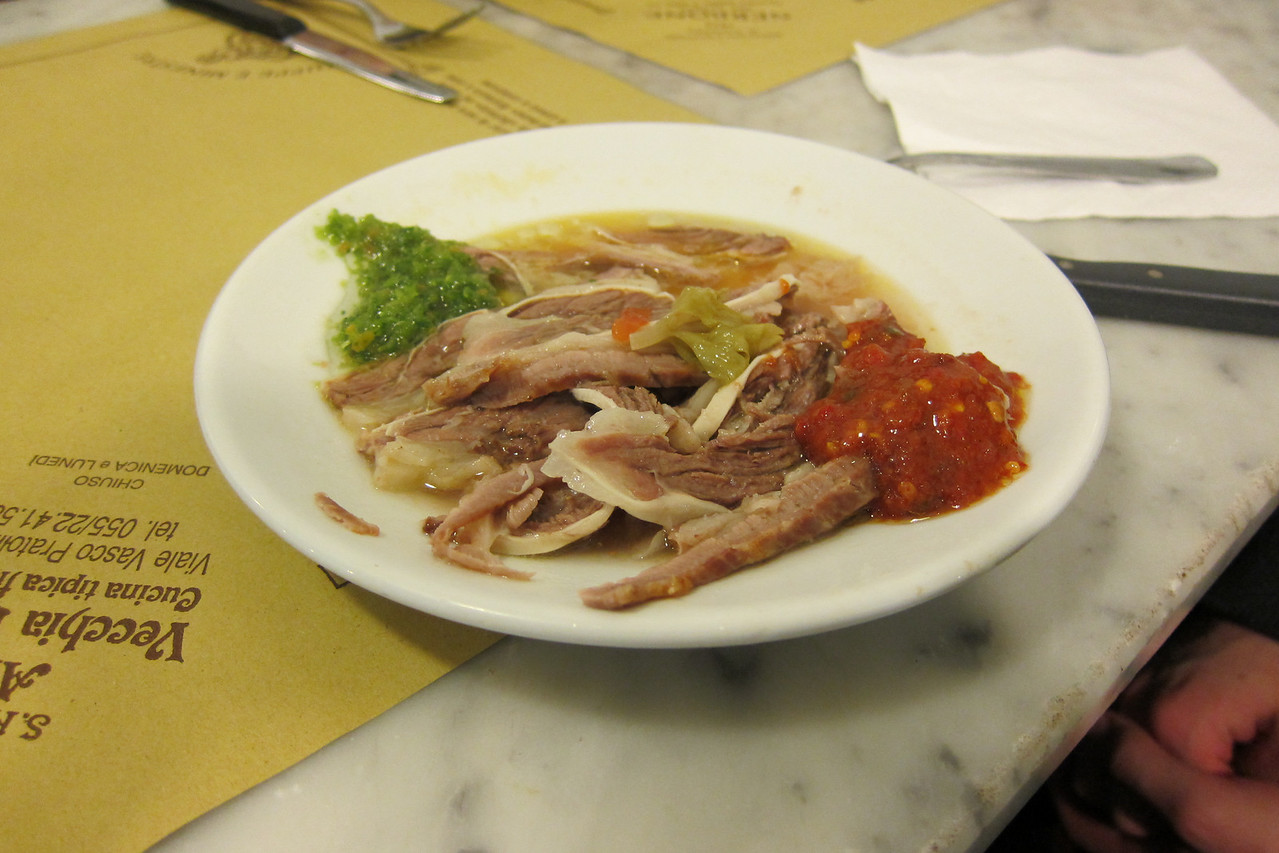 Boiled veal with spicy pepper sause (red) and another unknown sauce (green).