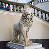 Lion figure  near the entrance at the base of the stairs.