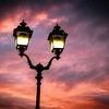 Antique electric street light and sky