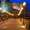 Evening image of Castel Dell Ovo in the Bay of Naples during the blue hour.