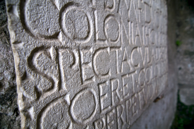 Part of inscription on entryway into colosseum.
