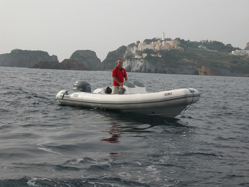 Ponza, Italy<br /> Richard, the activities director.  Preparing the Zodiac for a private tour around the island.