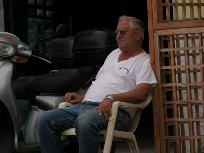Ponza, Italy<br /> Man in chair