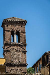 The eroding stonework of an old church bell tower in Rome