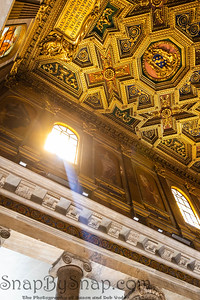 Light ray entering a Christian church lighting up the interior of the baroque interior