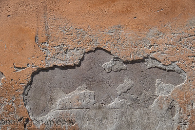 A stucco textured background on the wall of an old building in Rome