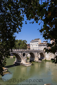 The Ponte Sistro bridge over the River Tiber flowing through Rome, Italy