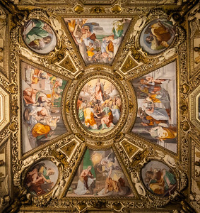 A fresco on the ceiling of a baroque style church in Rome