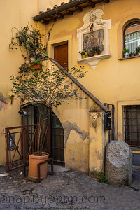 An old Italian door that is well aged in the Trastevere neighborhood of Rome