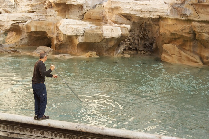 Cleaning the money @ Trevi Fountain Rome.