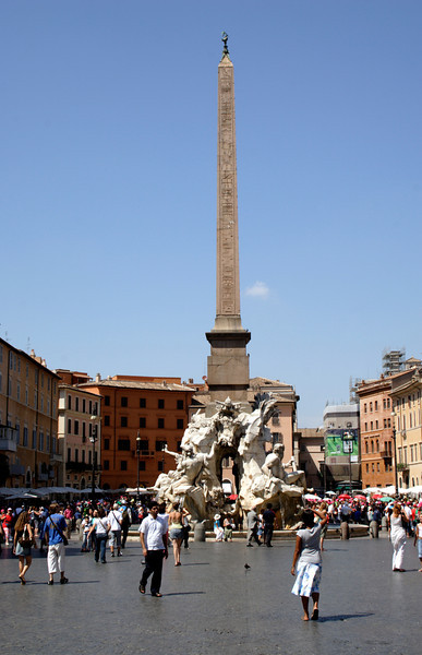 Obelisk and fountain of the four rivers at the Piazza Navona Rome