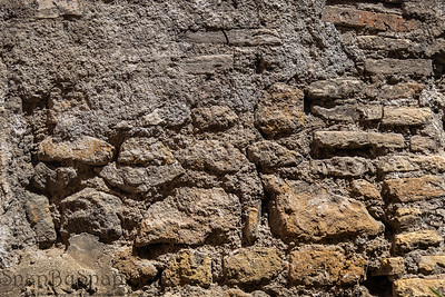 Heavily eroded, tanned colored bricks texture from the ruins of old roman walls