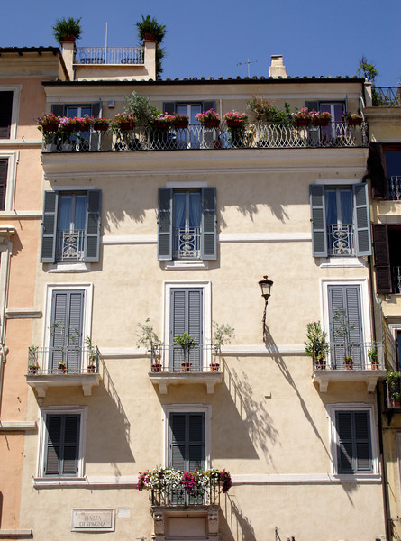 Ochre building facade at the Piazza di Spagna Rome