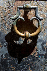 Brass knocker.