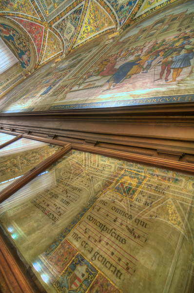 Library within Duomo di Siena.  Choir songbook in foreground.