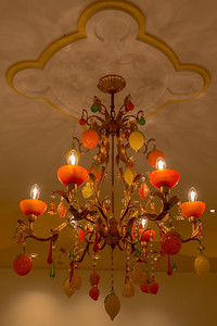 A chandelier with lemons and oranges.