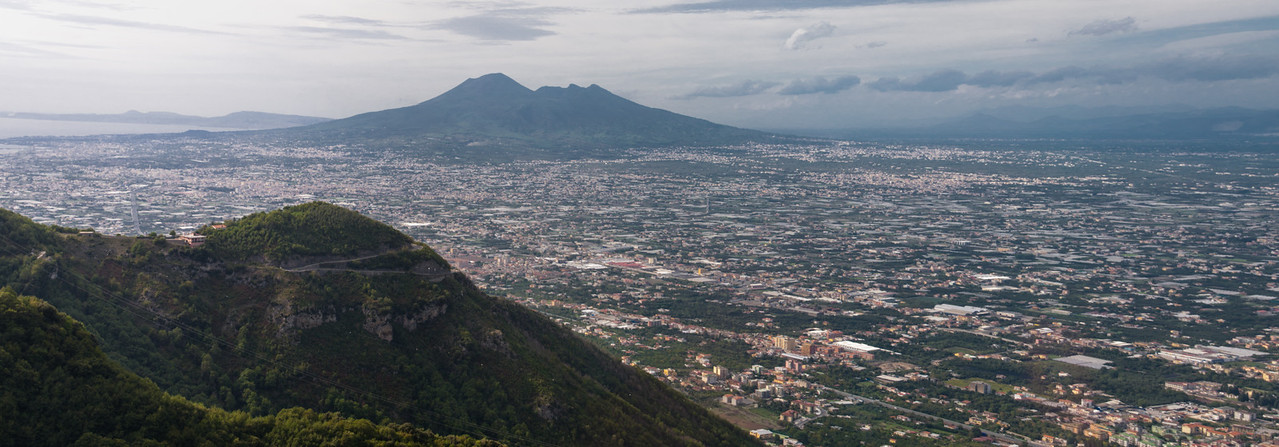 Vesuvius rising above the suburbs of Naples, Italy