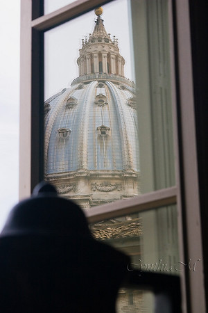 Reflection of St. Peter's Basilica in Vatican Museum