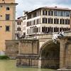 "The Ponte Vecchio (""Old Bridge"") is a Medieval stone closed-spandrel segmental arch bridge over the Arno River, in Florence, Italy."