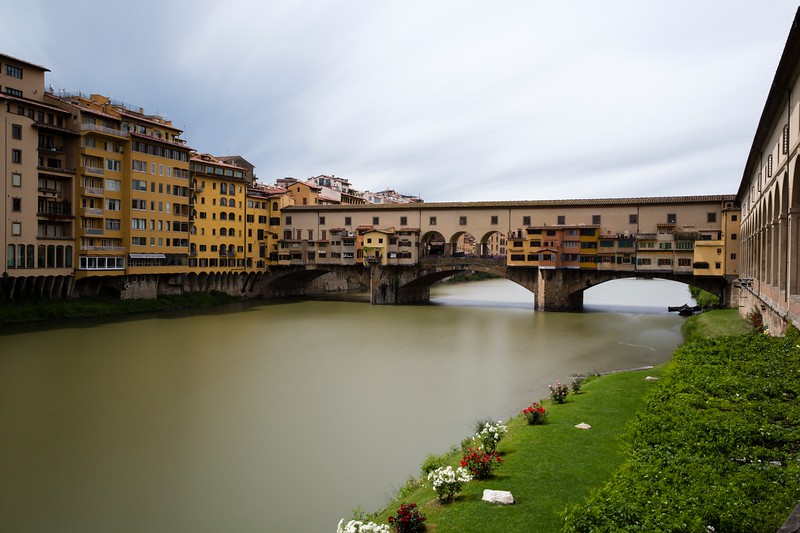 "The Ponte Vecchio (""Old Bridge"") is a Medieval stone closed-spandrel segmental arch bridge over the Arno River, in Florence, Italy."