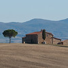 San Quirico d'Orcia on the way to Pienza evening light - another image frequently copied in postcards.