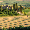 Tuscan farmhouse in the late afternoon - before the baling