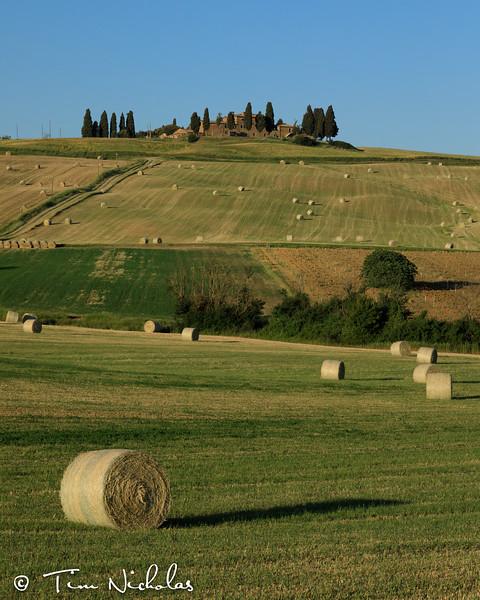 Hay bales around the farmhouse