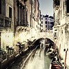 Vintage Restaurant and Gondola in Venice at night.