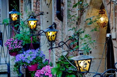 Detail of lights lining a building along a canal in Venice, Italy.
