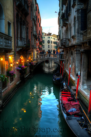 Evening on a Venice Canal with docked Gondolas