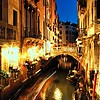 Restaurant and Gondola in Venice at night with Motion Blur