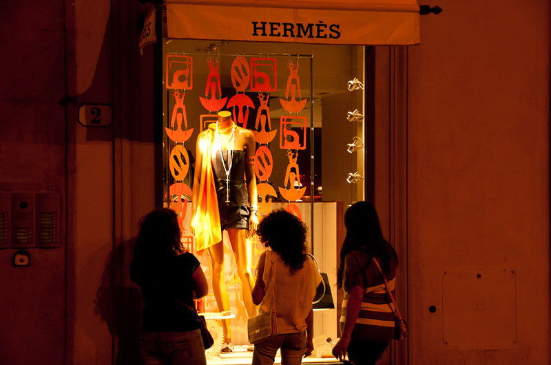 Women window shopping at midnight-Florence.