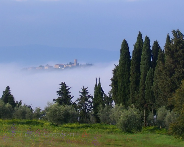 """""""San Gimignano"""" The mountain top town of San Gimignano, in the Tuscany Region of Italy, rises above the fog in this early morning shot."""