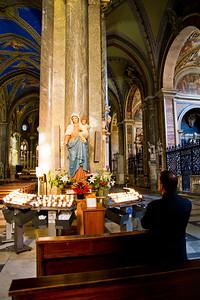 Priest praying at altar Santa Maria sopra Minerva Rome, Italy