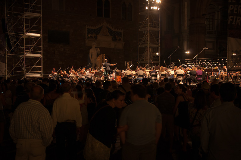 World renown conductor, Zubin Mehta performing at Piazza della Signoria-Florence, with David of Michelangelo in the background.