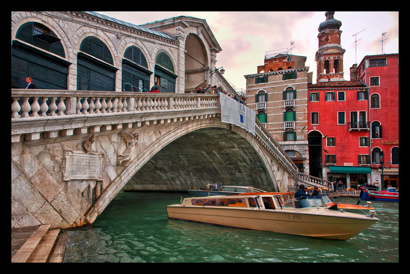 A view of the Rialto Bridge in Venice. The photo was taken after a rain with an overcast sky. We got soaked earlier and went back out in the afternoon.