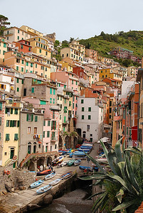 Cinque Terre, Italy - Houses Colliding - Travel by train, car, boat or by hiking up and down the hills.  A fabulous place to visit!