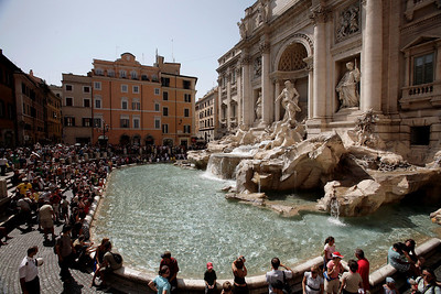 A crowded summer day at Trevi Fountain, Rome.