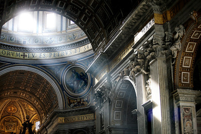 Sunlight filters through the upper reaches of St. Peter's basilica in Rome.