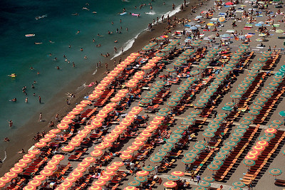 Beach umbrellas line the shore at Positano, Italy.