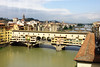 Ponte Vecchio bridge, Florence. From Wikipedia: The bridge spans the Arno at its narrowest point where it is believed that a bridge was first built in Roman times. The bridge first appears in a document of 996. In order to connect the Palazzo Vecchio (Florence's town hall) with the Palazzo Pitti, in 1565 Cosimo I de' Medici had Giorgio Vasari build the Vasari Corridor above it. To enforce the prestige of the bridge, in 1593 the Medici Grand Dukes prohibited butchers from selling there; their place was immediately taken by several gold merchants.