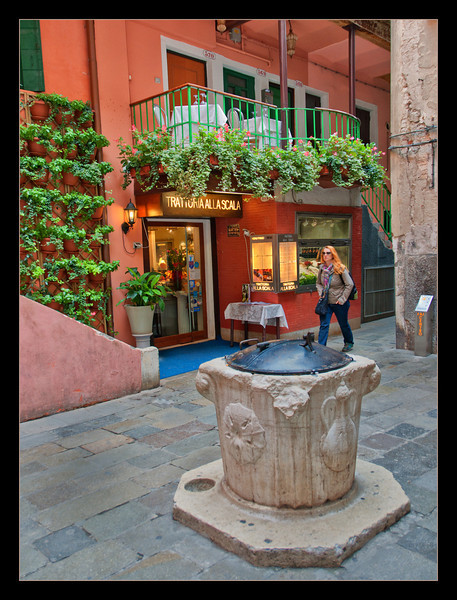 This is a community well in Venice. These wells are usually in all the small squares so that the surrounding buildings have a water source.