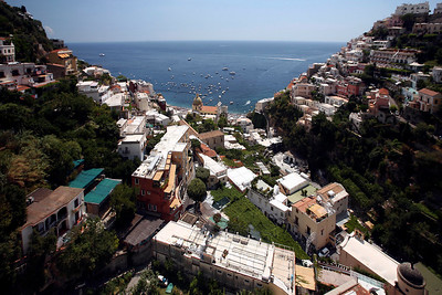 Houses and shops cascade down the cliffs at Positano, Italy.