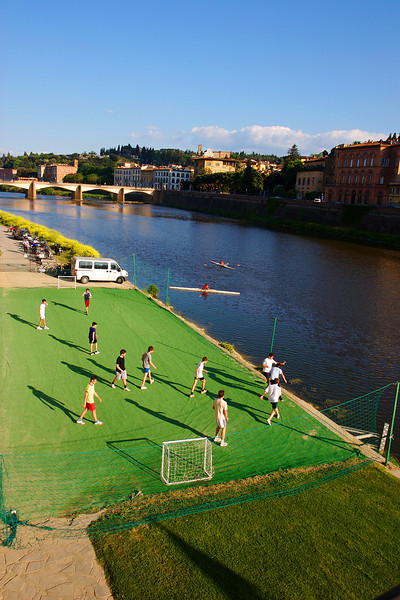 Afternoon football along the Arno River