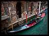 A gondola is parked off the main drag in Venice. The salt in the air is attacking the stucco on the walls. 10/2011